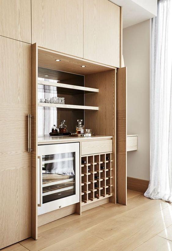 a small modern built-in bar with open shelves, a fridge and a wine bottle stand is a stylish idea that can be hidden