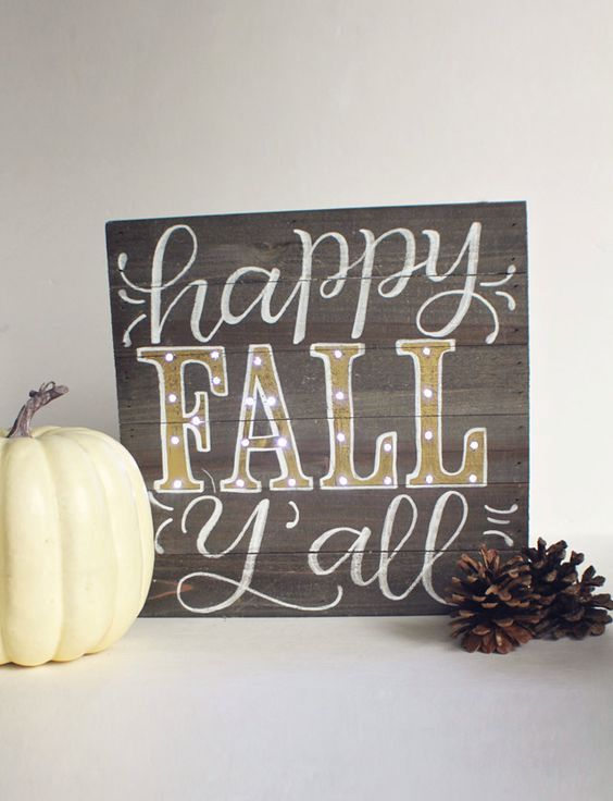 a stained wooden sign with white and gold letters is a chic and cute mantel decoration for the fall