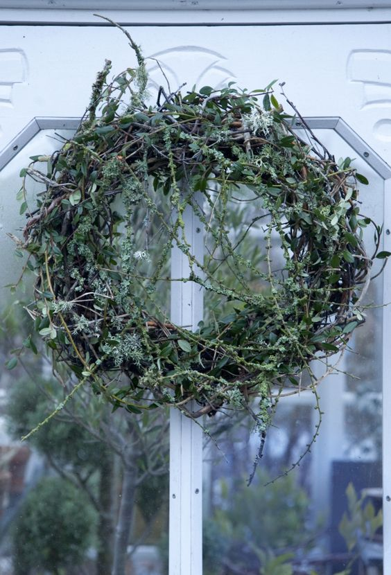 a textural woodland twig and greenery fall wreath with foliage will be a nice idea for both fall and summer