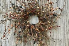 a twig and pip berry wreath is a natural and chic decoration for the fall