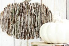 a twig pumpkin on a board is an easy rustic-inspired fall decoration you can make yourself