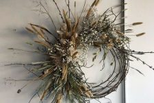 a vine and twig fall wreath with willow, greenery, baby's breath and dried touches will last long