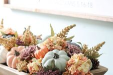 a wooden tray with dried blooms, leaves, muted color faux pumpkins is a beautiful and easy fall centerpiece