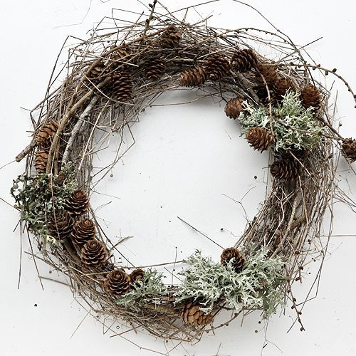 a woodland fall wreath of twigs, pinecones and pale greenery will bring a fall or winter touch to the space