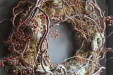a woodland vien and twig fall wreath with moss and berries looks very forest-like and inspires