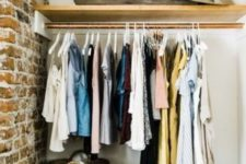 an open closet  in the corner with a holder for hangers and an open shelf plus baskets is a cool way to use a small nook