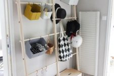 an open storage unit for accessories and shoes – some holders with hooks and boxes – closed and open supsended ones
