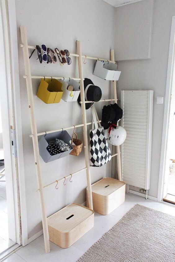 an open storage unit for accessories and shoes   some holders with hooks and boxes   closed and open supsended ones