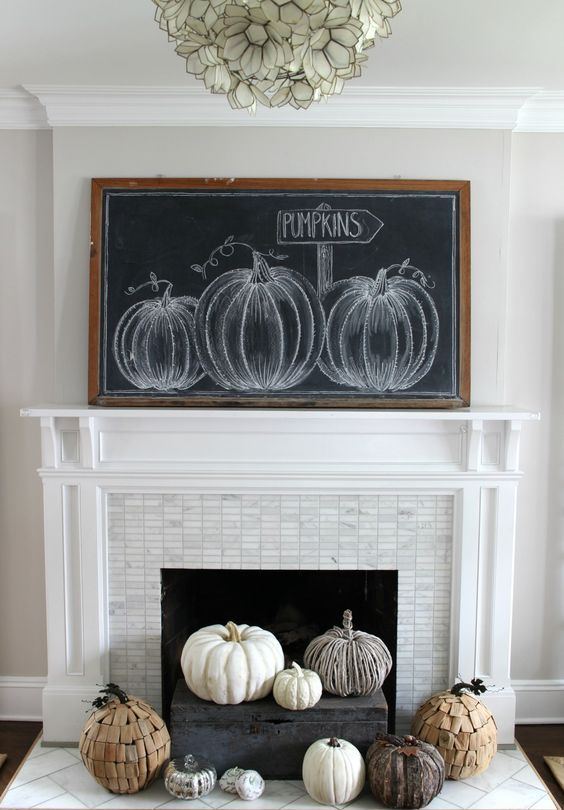 an oversized chalkboard pumpkin sign - chalk some pumpkins on it or whatever else you like