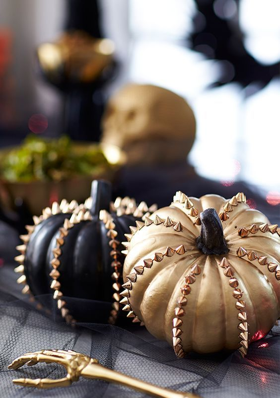 black and gold faux pumpkins with spikes are lovely for fall and Halloween and look very glam rock