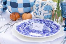 blue and white painted pumpkins to complete and a stylish blue and white fall tablescape with bright blooms