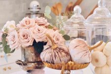 blush velvet pumpkins, a blush candle and blush roses in a vintage urn are amazing for a glam fall centerpiece