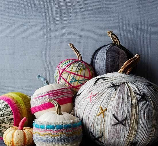 bright yarn pumpkins and neutral ones decorated with brigth fabric are easy DIYs to make for the fall