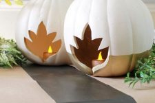 color block white and gold pumpkins with leaf cutouts and candles inside are amazing as fall lanterns