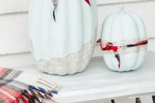 cool light blue pumpkins with silver glitter and palid ribbons are fun, glam and rustic at the same time