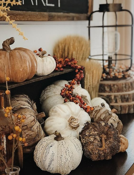 faux pumpkins, of fabric, plastic, bark and berries for a very naturalistic fall arrangement in your space