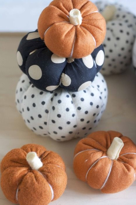 faux pumpkins of fabric - usual orange and poka dot are a fun and cute idea for a long-lasting decoration