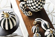 fun faux pumpkins and gourds painted black and white check and stripe prints are adorable and chic
