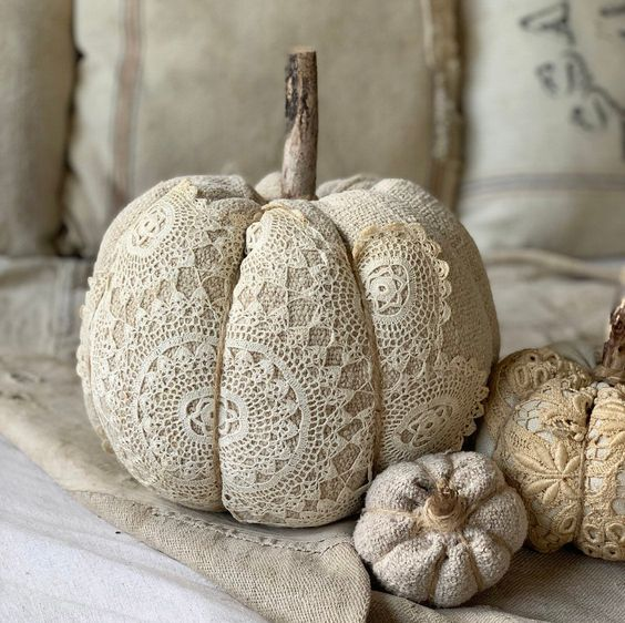neutral burlap and lace pumpkins with natural stems are amazing for decorating a shabby chic or vintage space