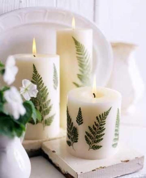 pillar candles with fern leaves attached add a woodland feel to your space and can be used not only in the fall but also in other seasons