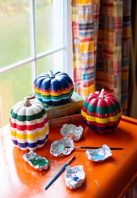 rainbow painted faux pumpkins are a fantastic bright idea for fall decor or for Thanksgiving
