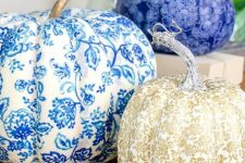 refined vintage-inspired blue, white and gold pumpkins covered with fabric are chic and non-typical