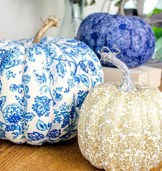 refined vintage inspired blue, white and gold pumpkins covered with fabric are chic and non typical