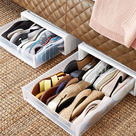small plastic drawers for shoes inserted under a closet, wardrobe or bed will help your oganize a bit