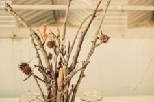 twigs with dried blooms and candles in jars with corn is a nice and easy fall centerpiece you can DIY