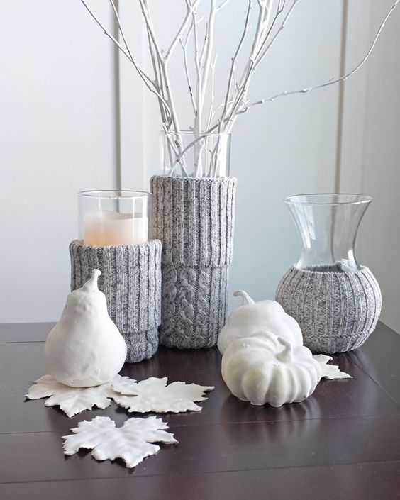 white faux veggies and fruits, white fall leaves, vases with whitewashed branches, candles with grey knit cozies