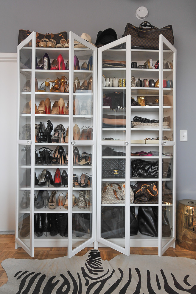 In a walk-in closet, the famous bookcase could become a storage and display solution for shoes and bags. (Cheban Interiors)