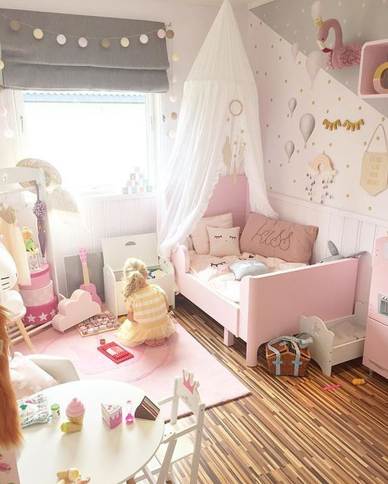 a cute grey and pink girl's bedroom with a pink Sundvik bed, grey shades, a lamp banner, pink decor and touches and whimsy wallpaper