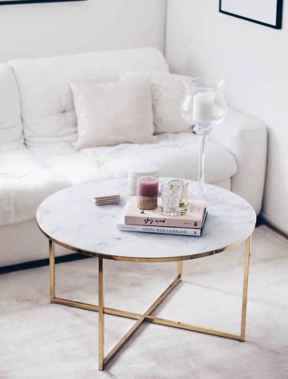 a glam marble coffee table with books, candles and glass coffee tables