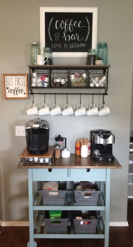 a home coffee bar with a blue IKEA Forhoja cart with a wooden countertop features a lot of open and closed storage
