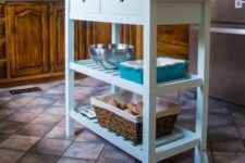 a light blue IKEA Forhoja cart with a wooden countetop as a small and cute kitchen island