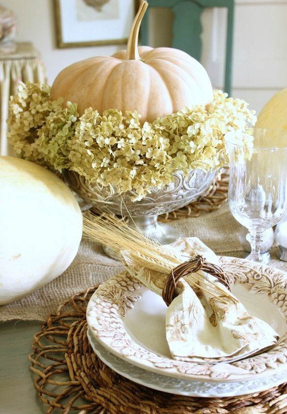 a neutral pumpkin, green hydrangeas in a crystal bowl form a gorgeous natural fall centerpiece