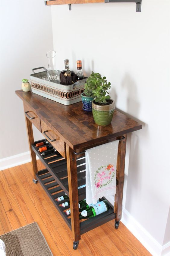 a rich stained IKEA Forhoja cart with a butcher block countertop becomes a mid-century modern home bar