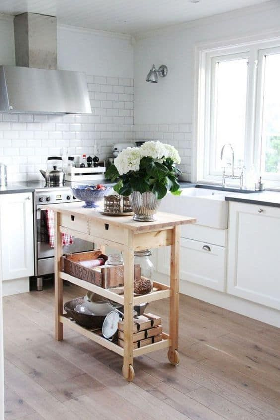 a small and chic kitchen island of an IKEA Forhoja cart with plenty of storage and a countertop