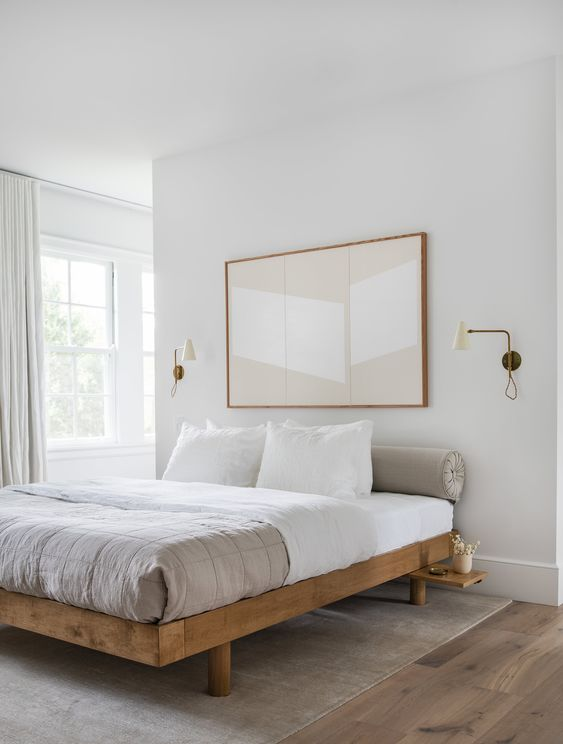 a small bedroom made visually exapanded with a neutral color scheme and an oversized art over the bed