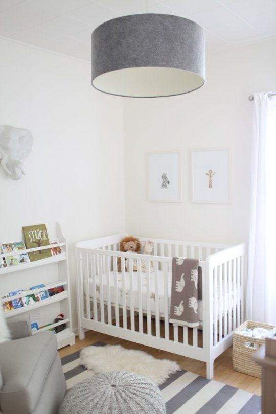 a soothing neutral nursery with an IKEA Sundvik crib, grey touches, faux fur and an open bookshelf