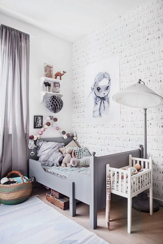 a whimsy grey kid's room with cool artworks, a garland, shelves, a grey Sundvik bed and grey curtains