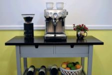 an IKEA Forhoja bar for your home – a cart hacked with grey paint and a black countertop, with all the necessary things