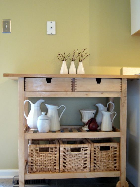 an IKEA Forhoja cart finished with baskets is a cool rustic piece for your home - for storage and not only