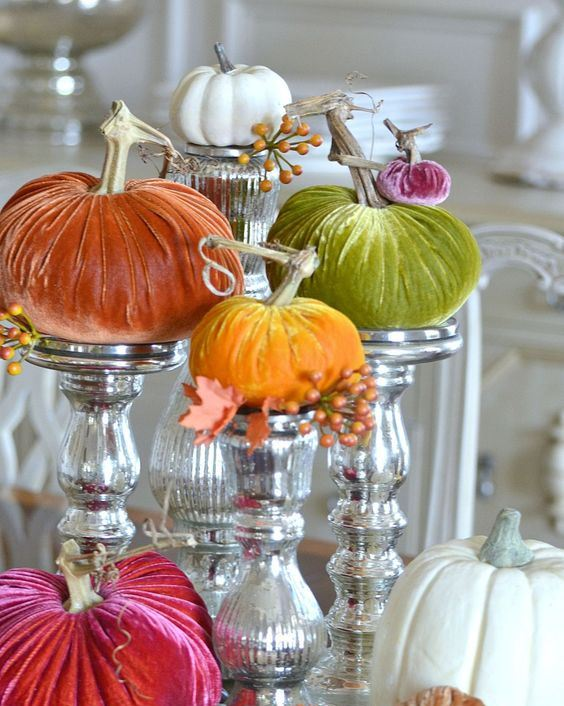 colorful velvet pumpkins on mercury glass stands is a whimsy and fun fall centerpiece to rock
