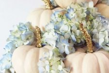creamy pumpkins with glitter stems, blue hydrangeas on a white porcelain stand as a glam rustic fall centerpiece