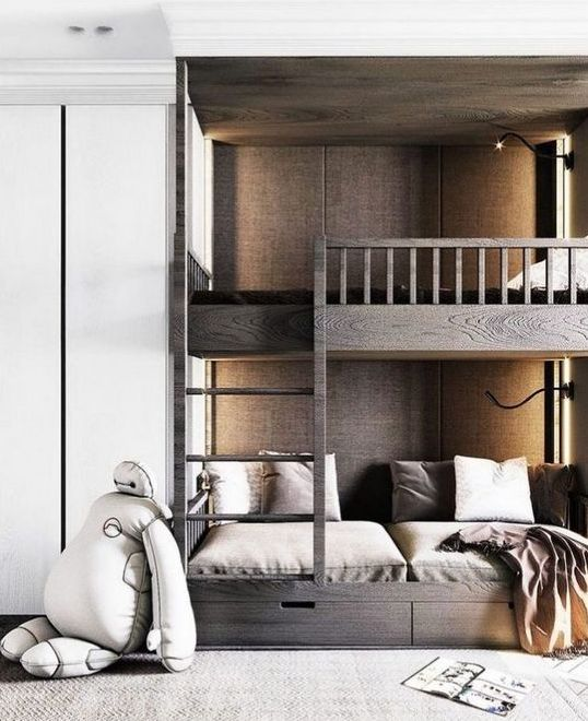 dark stained bunk beds with a ladder and storage drawers plus contemporary wall lights