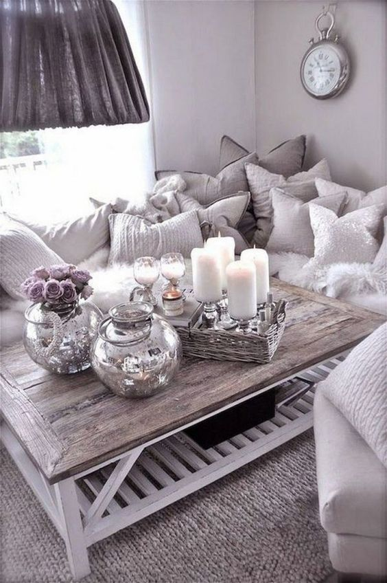 glam rustic styling with mercury glass vases, a woven tray with candles and some wine glasses