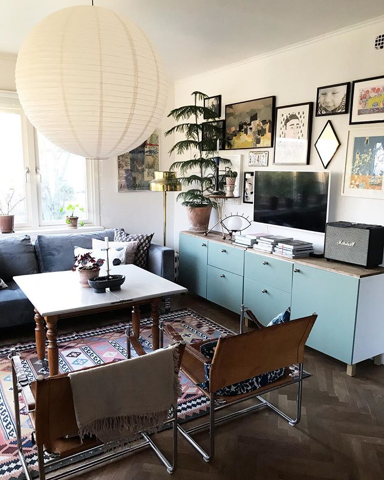 Mixing turquoise doors with wooden countertop is a great way to make your media console stylish (my_habitual_life)