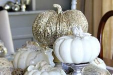 white and glitter pumpkins on metallic stands and with aux pumpkins under them for vintage glam decor