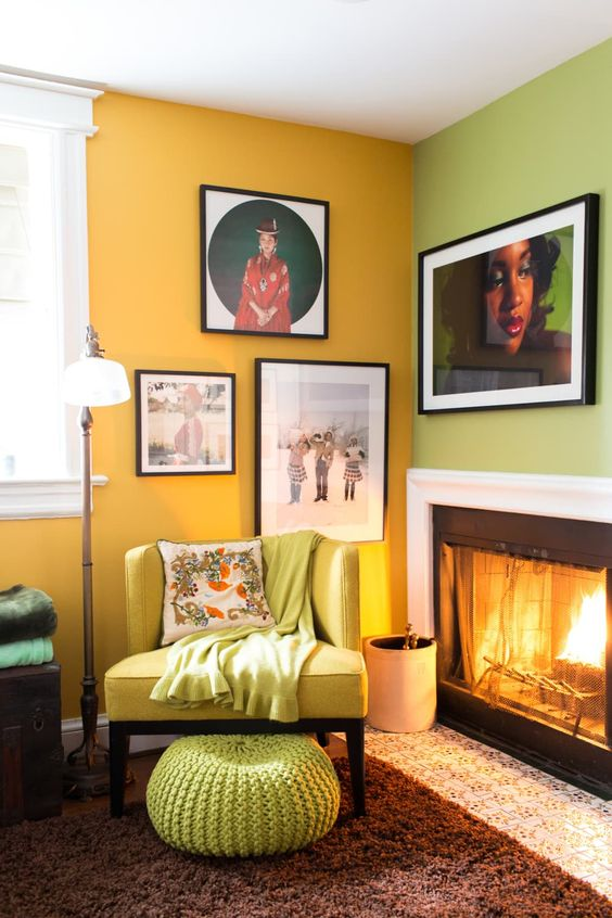 a colorful fireplace nook with a green and yellow wall, a gallery wlal, a built-in fireplace, a neon yellow chair and a neon green ottoman